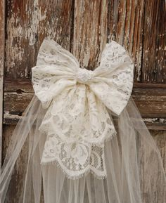 """Ivory Lace Bow with veil on a clear comb, matches """"Olga"""" flower girl dress. Communion veil. $20.00, via Etsy."""