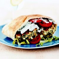 Tangy feta cheese and fresh mint dress up ground chicken in this flavorful and fast Greek Chicken Burger recipe.