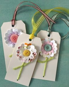 Die cut Flower Tags with buttons and yarn.
