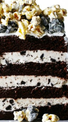 Triple-Stuffed Oreo Cake ~ Outstanding... super-moist chocolate cake is sandwiched between layers of super-creamy Oreo frosting and topped with mounds of super-addictive White Chocolate Oreo Popcorn.