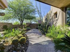 Modern Landscape/Yard with Fence, Raised beds, Pathway, exterior stone floors, Gate