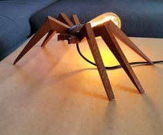 This is my attempt to make a spider shaped lamp. I used mahogany for this purpose and an Edison bulb.So lets get started,Tools And Materials: Wood (any kind, I used mahogany) Super glue Wood glue Sander Drill Rotary toolSandpaper8mm drill bit 28mm spade bit Band saw Miter saw Clear varnishPlease check out this video I have made to understand what is going on and to see the whole process: