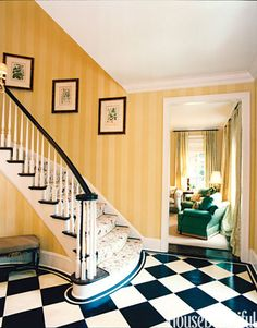 In this entrance hall, a tone-on-tone striped wallpaper from Nina Campbell's Bodleian collection brings the sun inside even on a cloudy day.   - HouseBeautiful.com