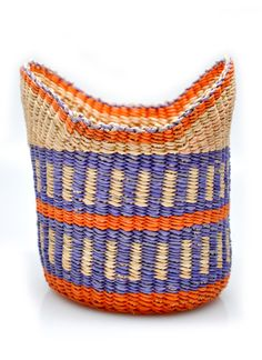 """Winged Woven Basket  $20.00Winged Woven Basket  $20.00 The perfect size for presenting a gift (or simply stowing on a console table), this colorful woven basket makes a cheerful, charming catchall.    -  Approximately 5"""" high x 4"""" deep   -  Dyed elephant grass   -  Color and pattern will vary   -  Handmade in Ghana"""