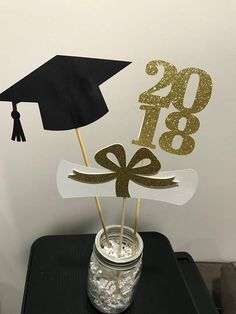 This is a set of 3 graduation stick for centerpiece DIY decorating. The base container is not included. Can be made in the color you wish even glitter colors You will receive 1 grad cap , 1 diploma and a 2018 Choose the color you want at checkout. also can be made in Red, pink, gold,
