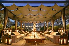 The rooftop garden, outfitted with wicker furniture and lanterns - RH's New West Hollywood Location