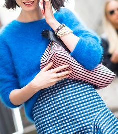 Fuzzy sweater tucked into a gingham print skirt