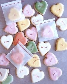 Conversation heart cookies with color flow royal icing and stamped message. So cute.