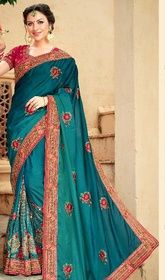 Greenish Blue Color Shaded Crepe Silk Sari #indiandesignersareesonline#designersari Be the sunshine of every person's eyes dressed in this greenish blue color shaded crepe silk sari. The appealing lace, patch, resham and stones work all through the attire is awe-inspiring. Upon request we can make round front/back neck and short 6 inches sleeves regular saree blouse also. USD$ 248(Around £ 171 & Euro 188)