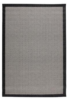 Mønstret med ensfarvet kant rundt om. Langsider med overlock og limede kortsider. Praktisk kvalitet af slidstærk polypropylene. Bagside af bomuld/jute. Støvsugning/skumvask.
