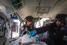 Flight nurse Kelly Bircher, left,  and flight paramedic Nick Herrington care for a trauma patient on board a Life Flight helicopter on route...