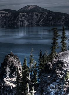 Crater Lake Oregon.I want to go see this place one day.Please check out my website thanks. www.photopix.co.nz