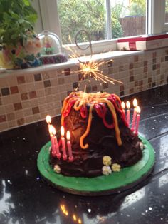 Volcano birthday cake.  There is a you-tube video I loosely followed. The glass with dry ice idea would have been fab but was too expensive for a small quantity.
