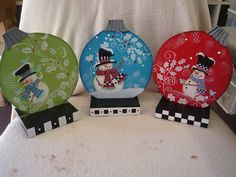 """Three Snowman 5-6"""" ornaments with stands"""