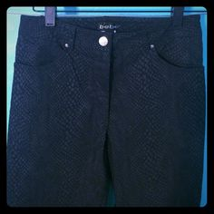 """Vintage • bebe Snakeskin Black Pants • 4 These vintage 1998 PRISTINE bebe 75% viscose black snakeskin print size 4 pants are an essential piece for the fierce/fearless fashionista. Pant legs have an 8-inch slit located at the bottom outer leg; slightly stretchy/yet sturdy material for ultimate form flattery. Inseam is approximately 24.5"""". Kept in perfect condition for my daughter; however, she'll pass me up in height next year at age 11! Whomever capitalizes on this rarity will be one happy…"""