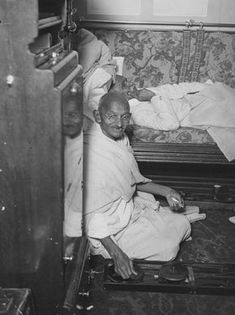 Mahatma Gandhi spinning in his cabin on board ship. Sir P Pattani, prime minister of Bharnagar, rests beside him. (Photo by Miller/Topical Press Agency/Getty Images) Rare Pictures, Historical Pictures, Rare Photos, Vintage Photographs, Famous Pictures, Mahatma Gandhi Photos, Indira Ghandi, Vallabhbhai Patel, Subhas Chandra Bose