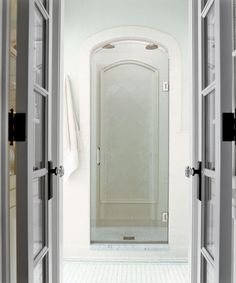 The arch of this shower doorway and interior tile details echo the bathtub's curves. | Photo: Nathan Kirkman | thisoldhouse.com