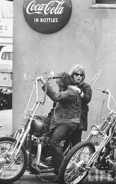 Ape-hangers, a real front brake ... and a Coca-Cola sign that's worth about $400 or so. Blackboard Cafe, Bakersfield. Hells Angels '65. Bill Ray photo.