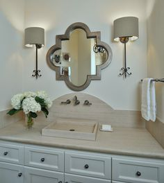 Powder room remodel with arched stone backsplash, wall mount faucet and quatrefoil mirror Bathroom Sconces, Bathroom Ideas, Wall Sconces, Master Bathroom, Bath Ideas, French Bathroom, Bathroom Updates, Brown Bathroom, Guest Bathrooms