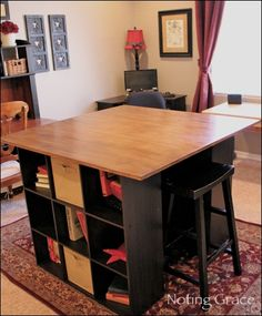 I would love this to be my working desk. I like the compartments in the side and it would be easy to cover it with boards to cut fabric on. I also like the height of it.