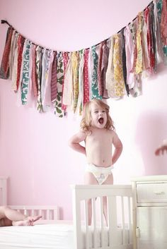 Fabric garland - what a fun decoration idea for the room of a little girl who adores pattern and color!