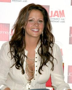 Sara Evans will be opening at the CMA Fest Riverfront!  I won't be there though!  :(