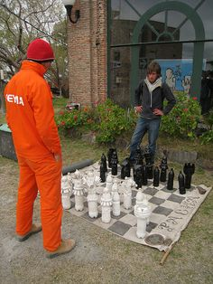 Paint and decorate plastic bottles and make a human size chessboard.