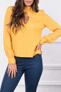 There's no denying the appeal of the stylish Mustard blouse. The soft fabric elegantly skims your silhouette and with a singular metallic button fastening, it's an elegant choice to partner with a pai