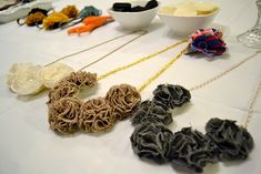 """Fabric pom pom necklace ideas.  These are great!  (I like them much better than the twisted flower bib necklaces.  I need a little lighter feel to my """"big"""" jewelry.)"""