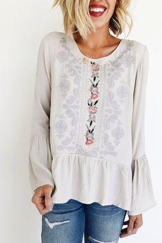 Light Grey Blouse  Embroidery Detailing  Scoop Neck  Large Almond Keyhole Back  Ruffled Peplum Hem  Long Bell Sleeves