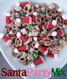 """This so-cute-you-almost-don't-want-to-eat-it recipe comes from Cookies and Cups.  What you throw in the mix is up to you, but here's what you'll need for those sweet Santa hats:  Bugles corn snacks (original or """"Sweet & Salty Caramel"""" flavor)  Red candy melting discs  Mini marshmallows  White sprinkles"""