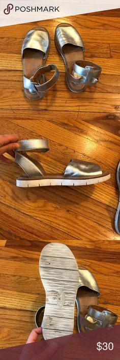 Too many shoes Cute leather Clark's Lydia Hala Sandal in metallic silver. Worn a few times. Structurally sound with a little wear on soles (see pics). Ankle strap-style. Look really nice on. Run one size large: marked as a 5.5 but fit like a 6.5. Clarks Shoes Sandals