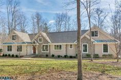 """This French Country Designed custom home ,built by Cecil Cobb, is  tucked away on a private  3.5 acres at the end  of  a culdesac in Fieldstone.  Truly maintenance free genuine Stucco and stone exterior  and slate patio and entrance.   One level living with a large bonus room or bedroom on the second floor. The wood flooring is """"Jefferson Monticello"""" design."""