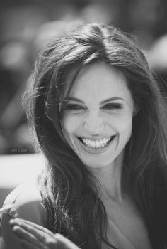 Angelina Jolie... mostly cause she's bad ass...her mom passed away years ago and she still weeps but smiles and laughs too...so I'll be ok, just not tonight (wrote this when dad passed away-Mari)