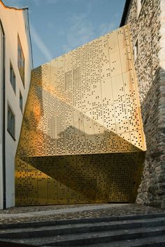 """MLDZ's deconstructed, gold pegboard is actually a museum.  """"This is Janus, an addition to the Rapperswil-Jona Municipal Museum"""" in Switzerland.  Click through for more info and photos."""