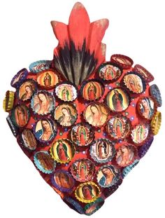 "Guadalupe Bottlecap Heart All Guadalupe, all the time. Mounted on a lovely carved wood ""sacred heart"", many different images of Guadalupe to watch over you. Handcrafted in San Miguel De Allende, Mexico. Guadalupe images set into tin bottlecaps add a folksy charm."