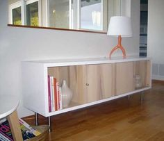 Ikea hack.  Just white paint on the outside.  Medial Console for playroom?