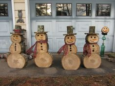Snowmen made from tree stumps More