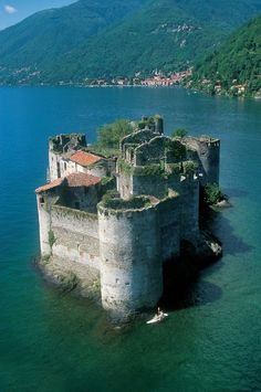 The Cannero Riviera is in the Province of Verbano-Cusio-Ossola in the northern Italian region of Piedmont. The Castles of Cannero are today picturesque ruins on two rocky islets close to the shore on Lago Maggiore. The Rocca Vitaliana fortress was built between 1519 and 1521.  by Giorgio Gnemmi