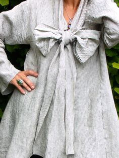Tie shirt in winter weight Irish linen, gray and white pin stripe, V neck, full wide bow tied at V point, flared body, straight long sleeves
