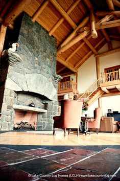 Great Room with Custom Stone Fireplace and Dall Sheep of a Post and Beam Log Home
