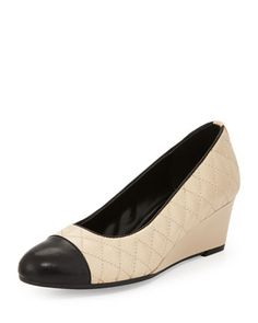 Neiman Marcus twotone quilted and smooth leather wedge.Round captoe.Round cut vamp.Pipe trimmed collar.Covered 2 wedge heel.Padded insole.Rubber outsole provides some traction.Lancer is imported. #Fashion  #LastCall
