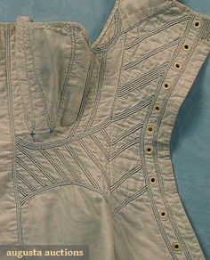 Augusta Auctions: 1820-30. White linen with white twill cotton lining. corded wtih blue embroidery