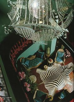 James Coburn's house designed by Tony Duquette. Zebra skin rug, turquoise silk upholstery and walls, a coral iron railing and a chandelier built around a disco mirror ball. Zebra Skin Rug, Zebra Rugs, Appartement Design, Décor Boho, Bohemian Gypsy, Oui Oui, Chinoiserie, Decoration, Icon Design