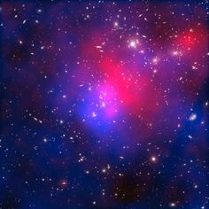 Composite image of the galaxy cluster Abell 2744, also known as Pandora's Cluster, taken by the Hubble and Chandra space telescopes and the Very Large Telescope in Chile. Hot intracluster gas is shown in pink, and the blue overlay maps the location of dark matter.