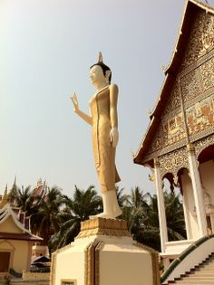Buddha statue at the wat adjacent to the Pha That Luang in Vientiane, Laos.