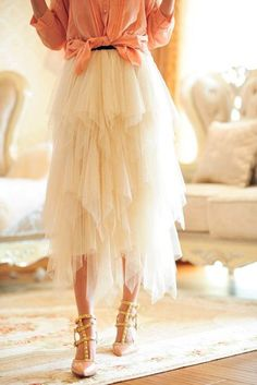 Cream Tulle skirt.  Easy fun skirt to make: two pieces of 4 yards of tullie, cut one 1/4 long then as you gather it lift eacg piece 1/2 inch. Do the same for the other 3. Ok dig this layering. Brides Maids?