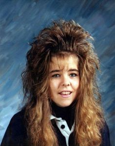 awkward family photos  [i miss the 80s]....LOL! maybe shes having a bad hair day???