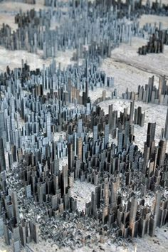 Ephemicropolis (2010) by Peter Root.    100,000 Staples  Approx floor area 600x300cm    Stacks of staples were broken into varying sizes from full stacks about 12cm high down to single staples. These stacks were then stood up and arranged over a period of 40 hours.