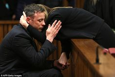 The family of Oscar Pistorius, pictured, have claimed they have been warned he will be beaten up and gang raped in prison unless they pay a bribe